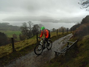 Lee leaving Skelghyll Woods, with Lake Windermere merging with the clouds behind.