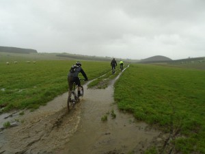 Mike, Stephen and Marc riding through the puddles on Pen y Gwely.