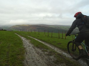 Stephen with a view of Worlds End at the start of the Three Trees descent into the Vale of Llangollen.