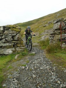 Brian threading the gate on the Bwlch y Rhiwgyr descent.