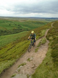 Sean climbing the Mickleden Edge singletrack.