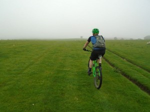 Tom crossing a misty Pen y Gwely.