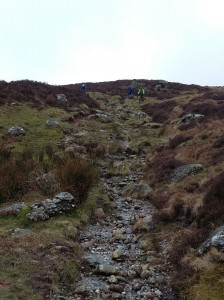 Choosing a line on the steep final descent to Llyn Cowlyd.