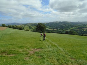 Crossing the grassy field on the Cefn Grugos descent.