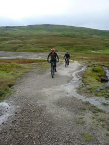 Brian and Karl riding through the Black Mires earthworks.