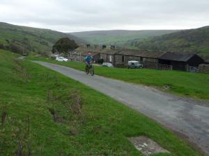 Brian climbing from Gunnerside.