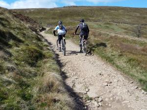 Laurence and Paul climbing the Pennine Bridleway from Widdop Reservoir.