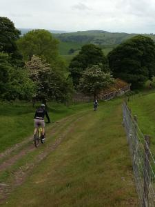 Chris and Anne on the Priory Cottage descent on Long Mynd.