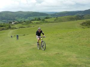 Chris on the long, grassy Cross Dyke climb on to Long Mynd.