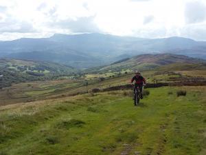 John on the long, grassy Braich climb with Cadair Idris behind.