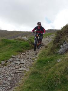 John on the fast and rocky Bwlch y Rhiwgyr descent.