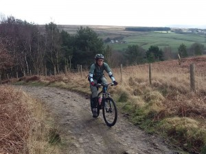 Kath climbing to Healey Nab woods.