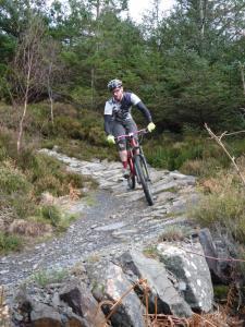 Gavin on the Creigiau Pandora stone berm of the Gwydir Mawr trail.