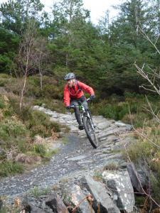 Steve on the Creigiau Pandora stone berm of the Gwydir Mawr trail.