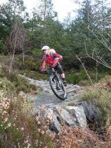 Stuart on the Creigiau Pandora stone berm of the Gwydir Mawr trail.