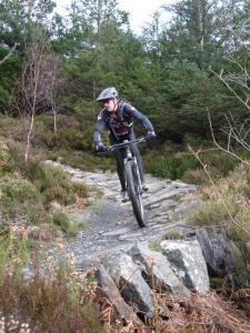 Tony on the Creigiau Pandora stone berm of the Gwydir Mawr trail.