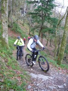 Tony and Martin climbing the Parc a reid singletrack at the start of the Gwydir Mawr trail.