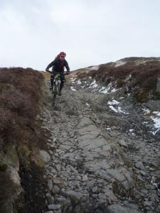 Graham on the rocks at the top of the Parkamoor descent in the Lake District.