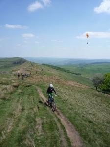 Anne climbing the Rushup Edge sinlgetrack.