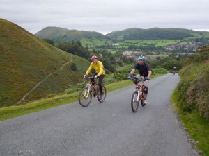 Colin and Dan on the long and steep road climb from Church Stretton.