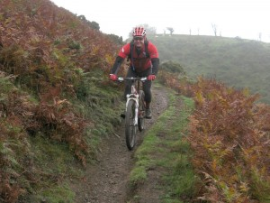 Chris descending The Batch singletrack.