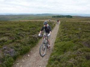 Craig climbing to the Pole Bank summit on Long Mynd.