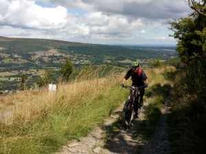 Nick at the top of One Giant Leap climb above Llangollen.
