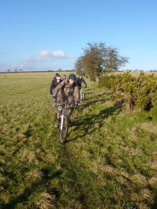 Seb leading the pack through the fields on the Ceiriog Trail.