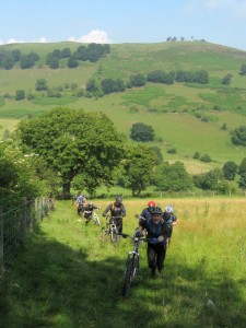 Pushing up through the fields at the start of the Gyrn Moelfre climb.