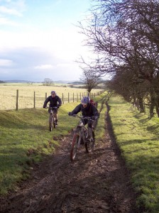 Paul and Jim on the muddy and rutted climb to Llechrydau farm.
