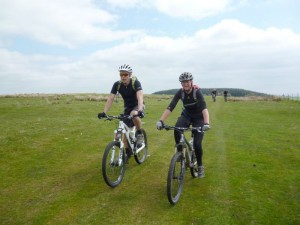 Ian and Jill riding over Pen-y-Gwely.