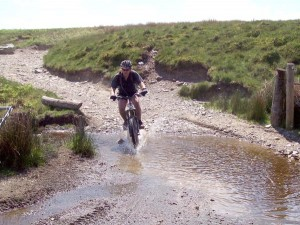 Paul crossing the ford on Bryn Du.
