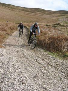 Chris on the loose gravel of the Moel Dywyl descent, into the Vale of Clwyd.