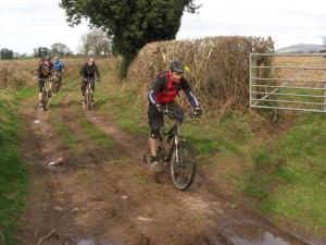Simon on the muddy double track in the Vale of Clwyd near Ruthin.