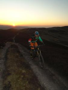 Gareth at sunset on the Moel Dywyll concessional trail along the spine of the Clwydian Range.