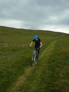 Adrian on the long, grassy descent from Moel Famau into Vale of Clwyd.