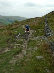 Jan on the rocky and muddy trail around Moel Famau.