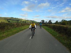 Tom leading the pack from the Four Crosses junction.