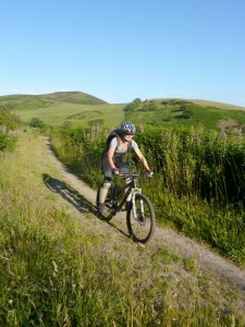 Becky descending through Llangwyfan Forest.