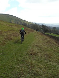 Andy on the grassy trail to Nant y Ne ford.