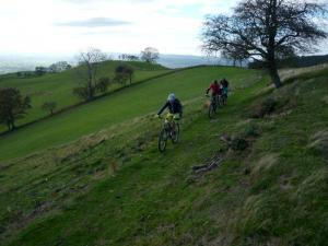Nige, Tim and Matt on the grassy singletrack to Moel Arthur.