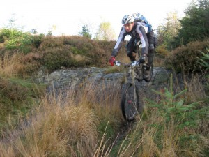Steph rolling the drop at the top of the Satterthwaite descent.