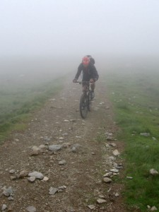 Mark climbing Raise in the clouds, heading to the summit of Helvellyn.