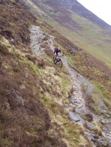 Paul riding the jagged rocks on Lonscale Fell.