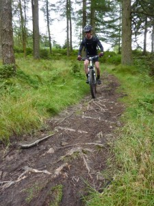 Mike on the rooty singletrack in Broughton Moor forest.
