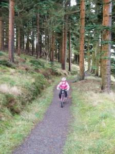 Anna on the first singletrack climb of the Alwen Reservoir cycle trail.