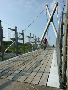 Col (flattyres) crossing the Machynlleth cycle bridge.