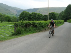 Connor riding through the Afon Dyfi valley.
