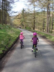 Anna and Elisabeth following the lane by Derwent Reservoir.