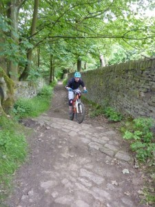 Dan climbing the Pennine Bridleway out of Birch Vale.